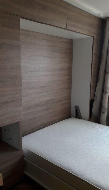 Кровать-трансформер в стене
