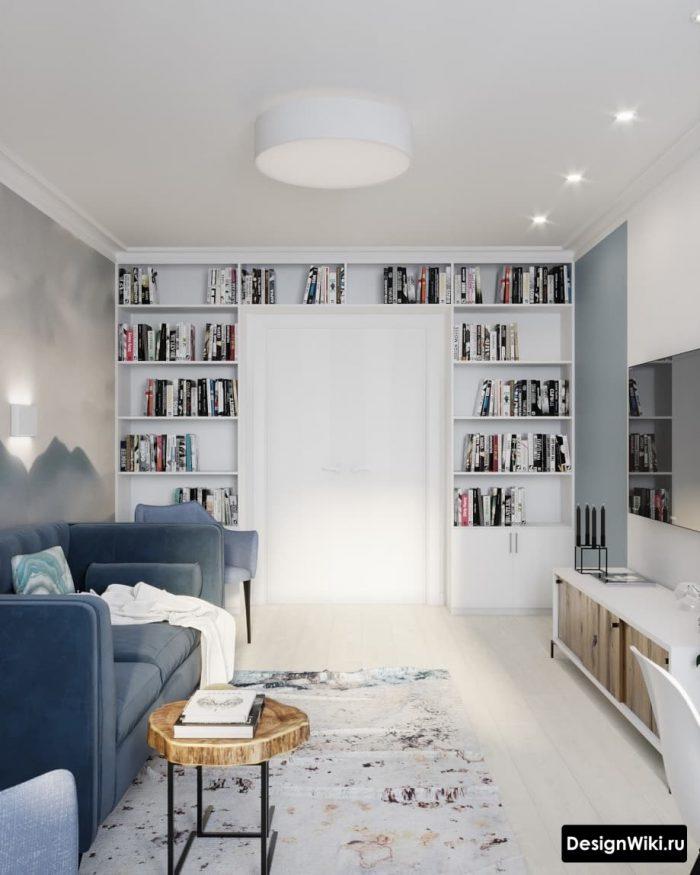 гостиная в скандинавском стиле с полками для книг у стены