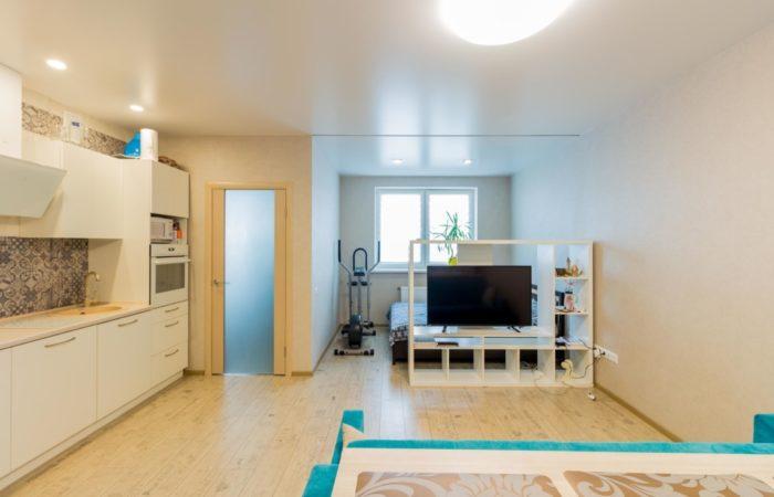 Современный скандинавский дизайн кухни-гостиной