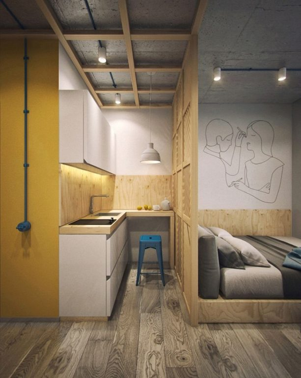 Квартира-студия с маленькой кухней и кроватью