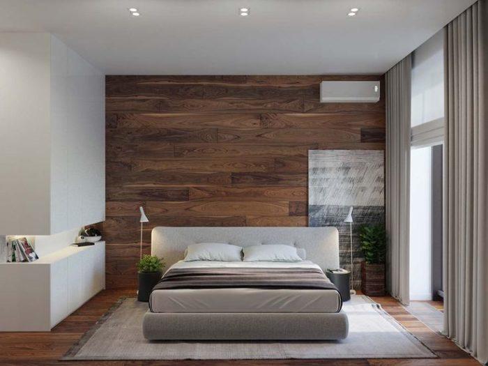 Ламинат на полу и стене в спальне