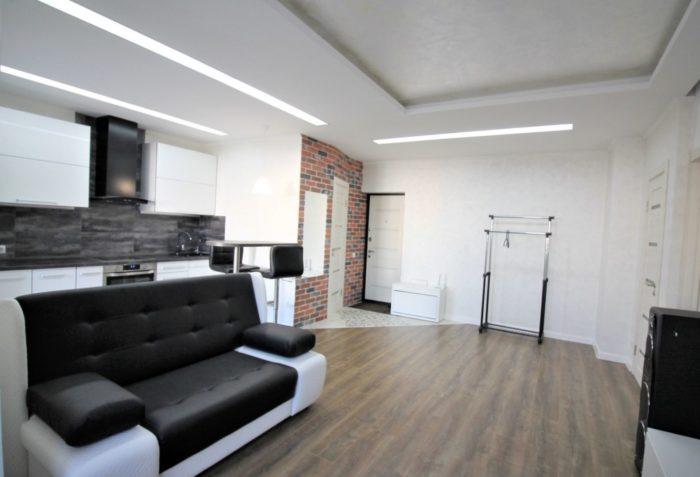Нужна ли плитка в прихожей и кухне в студии