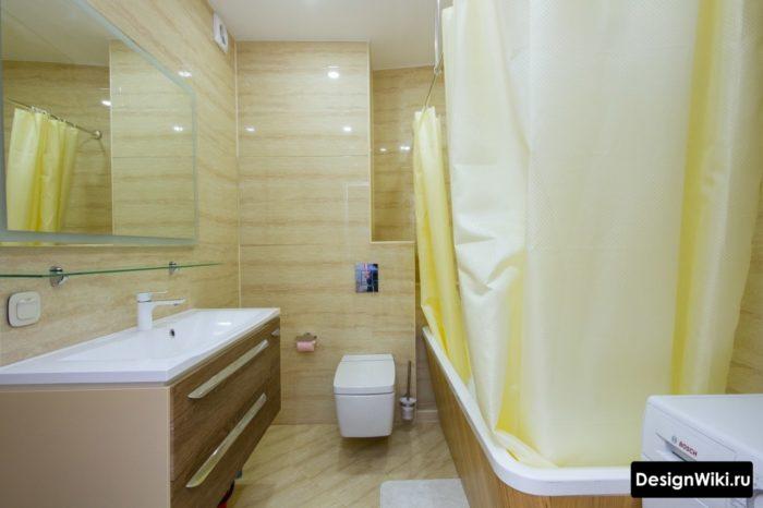 Интерьер ванной со стиральной машиной в глянцевой плитке