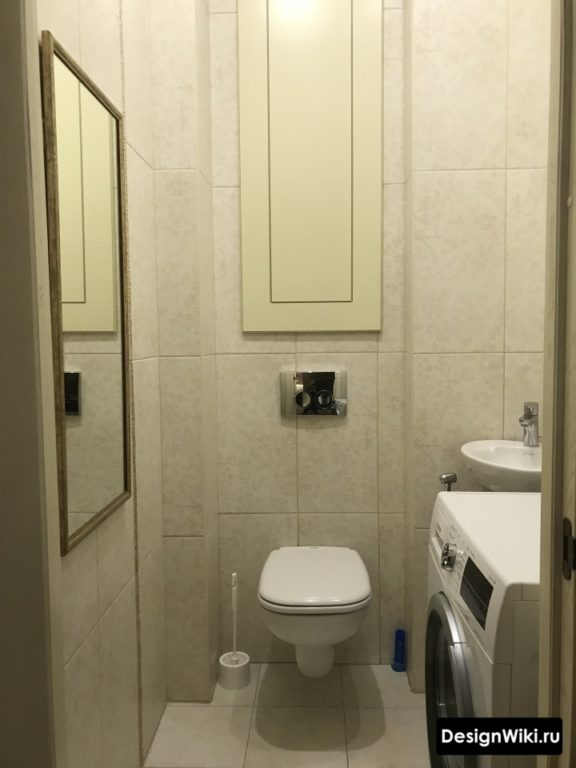 Интерьер туалета со стиральной машиной