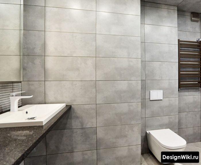 Современный дизайн ванной с плиткой под бетон