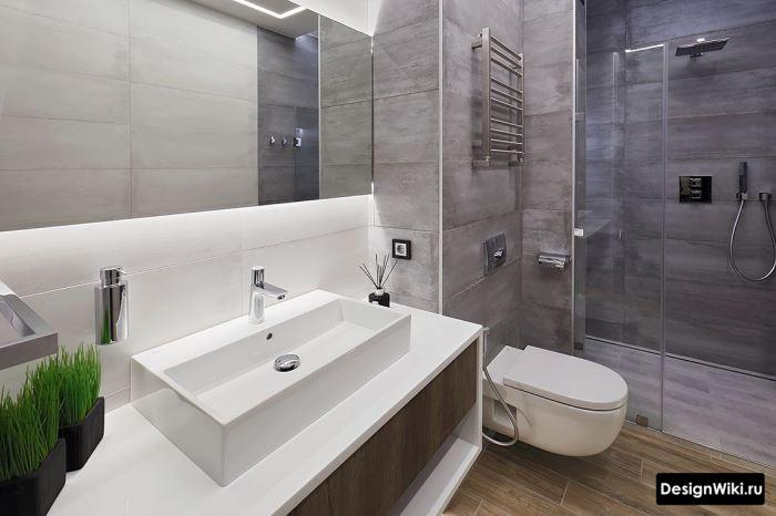 Современная отделка ванной комнаты серой плиткой