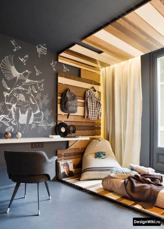 Стильный дизайн комнаты мальчика подростка с черными стенами и потолком