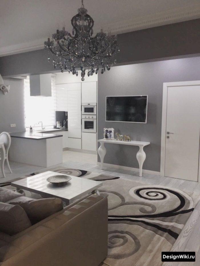 Дизайн кухни-гостиной в классическом стиле с островом