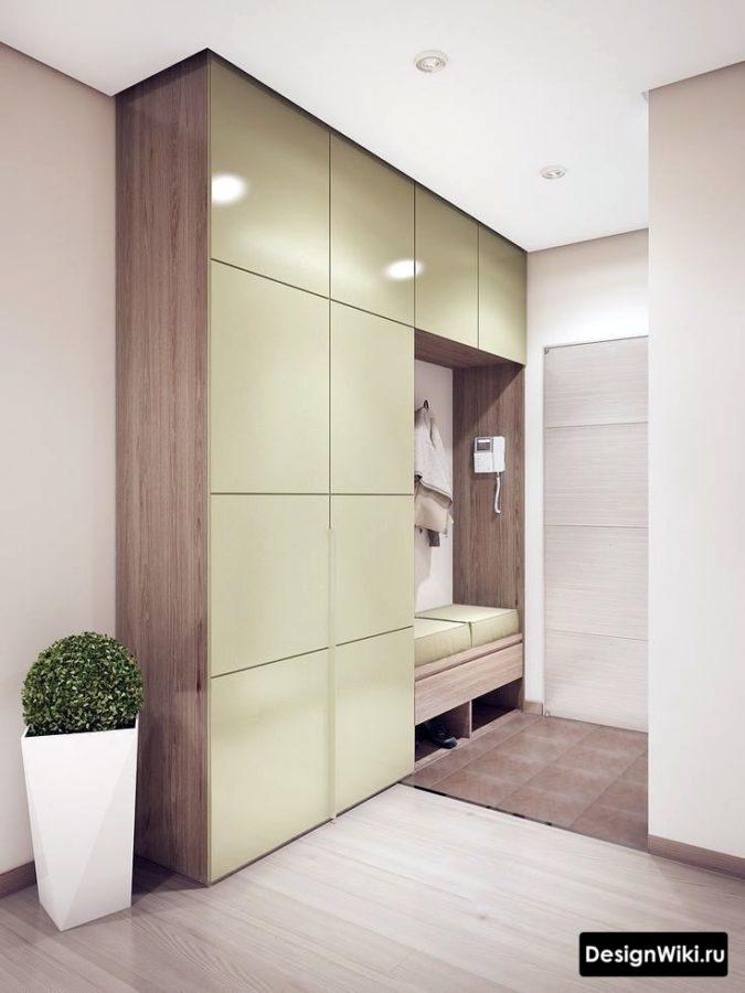 Оливковый шкаф до потолка в интерьере прихожей