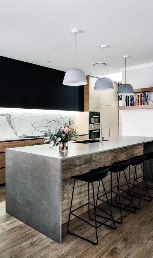 Широкая барная стойка из бетона на кухне