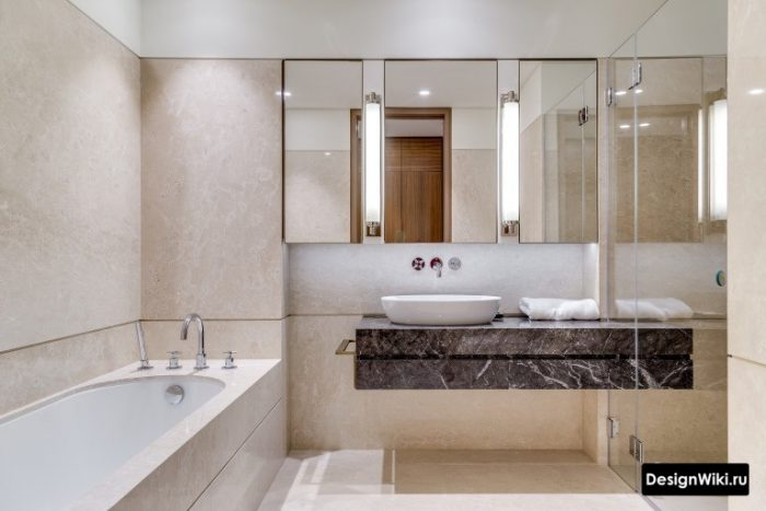 подвесная тумба с чашей и встроенным смесителем в ванной комнате