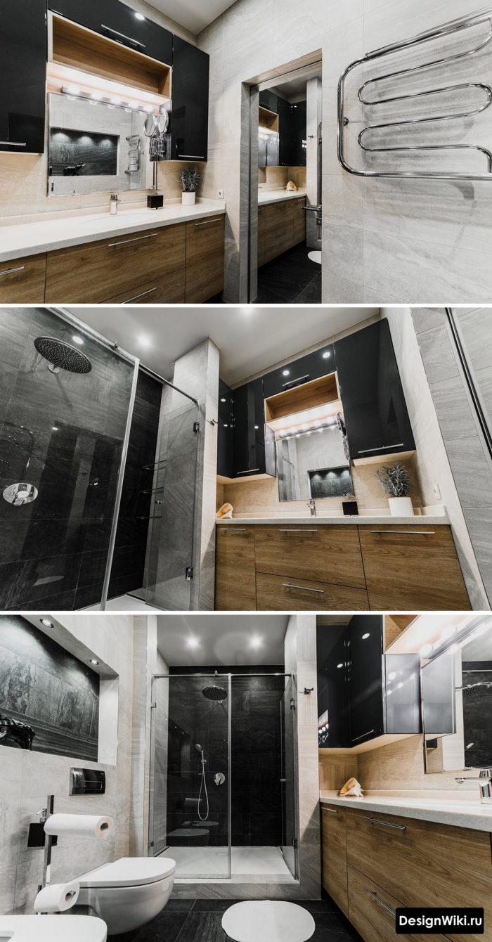 черные шкафы возле зеркала в современной ванной комнате