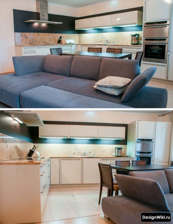 Обеденный стол и диван в современной кухне-гостиной