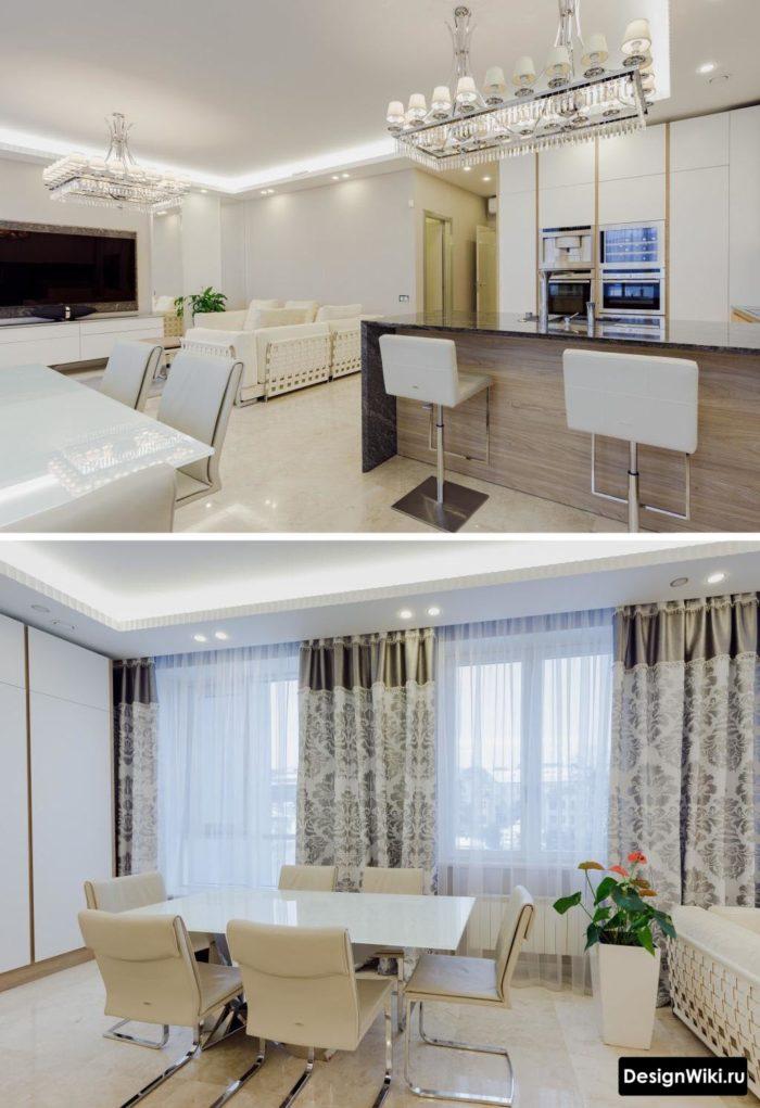 Стол из белого матового стекла в кухне совмещенной с гостиной