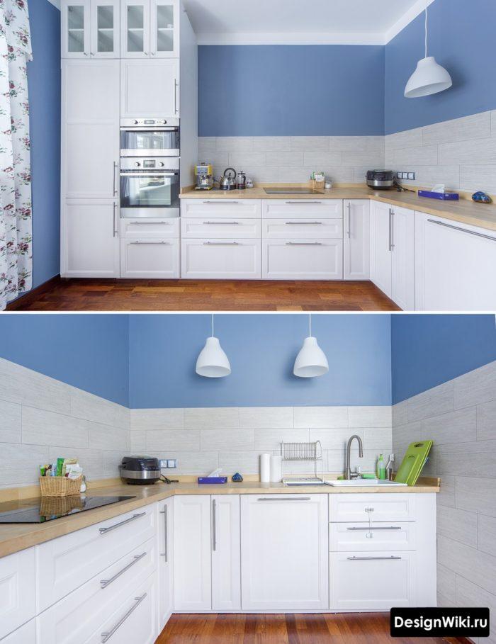 Белая кухня в скандинавском стиле без верхних шкафов с голубой стеной