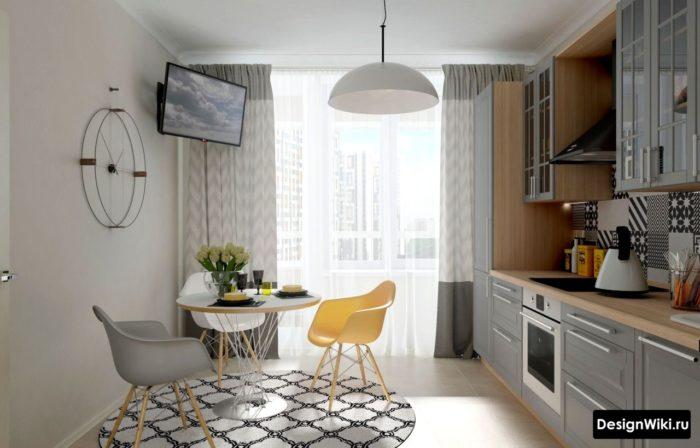Дизайн кухни с серой мебелью и желтым стулом
