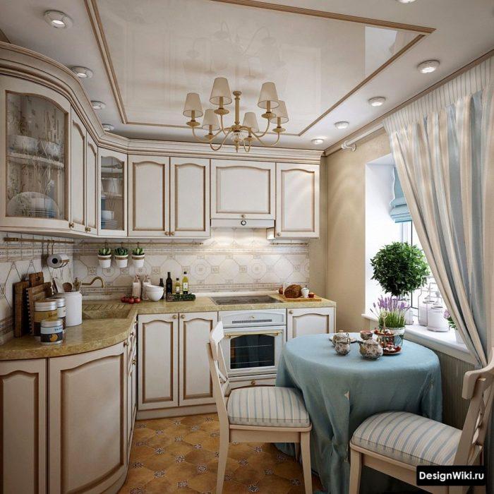 Бело-голубые шторы в интерьере кухни в стиле прованс