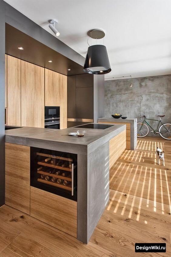 Дизайн кухни в стиле лофт с толстой столешницей из бетона и деревом