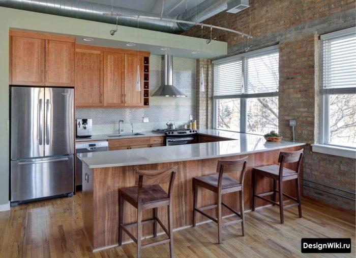 Кирпичные стены в маленькой кухне в стиле лофт