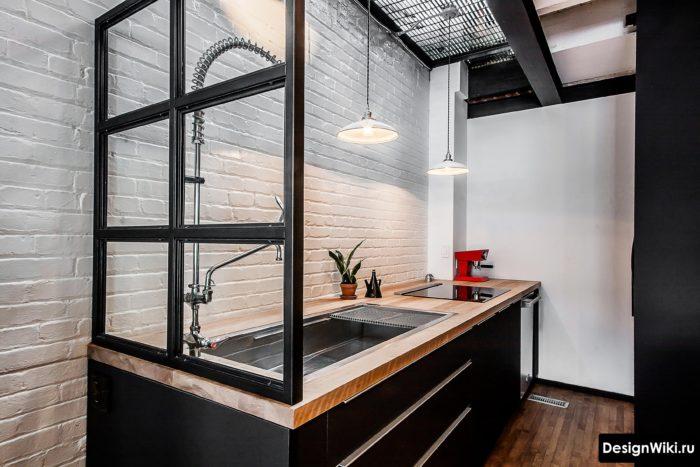 Стиль лофт с отделкой стен белым кирпичом на кухне