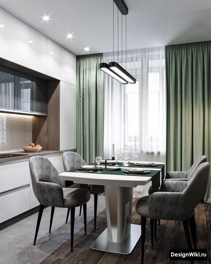 Зелёные шторы на белой кухне с балконной дверью
