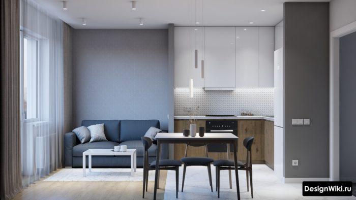 Маленькая кухня-гостиная с серыми шторами