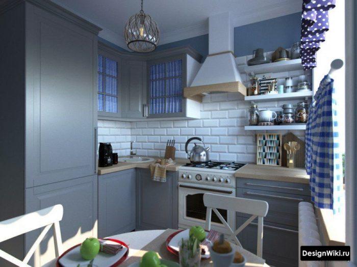 маленькая серая кухня со встроенным холодильником