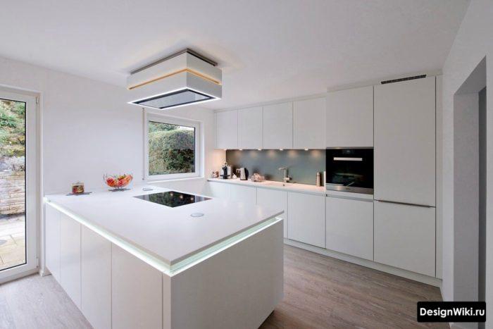 дизайн кухни в стиле хай тек в частном доме с островом